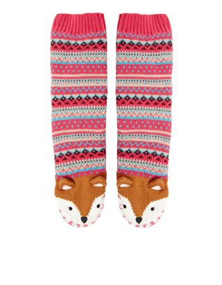 These super-cosy slipper socks are knitted with a Fairisle ...