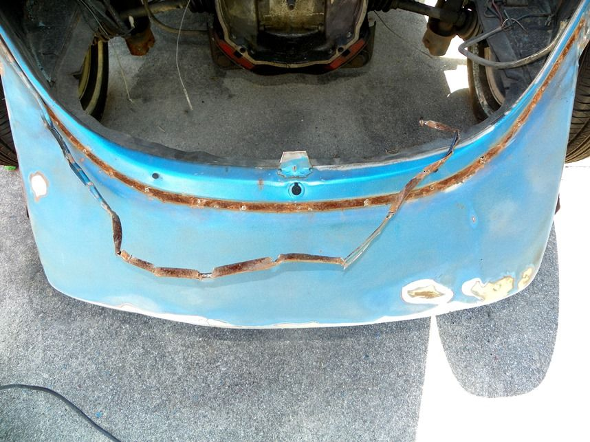 Removing the useless rear deck seal channel which as you can see is a total rust magnet.