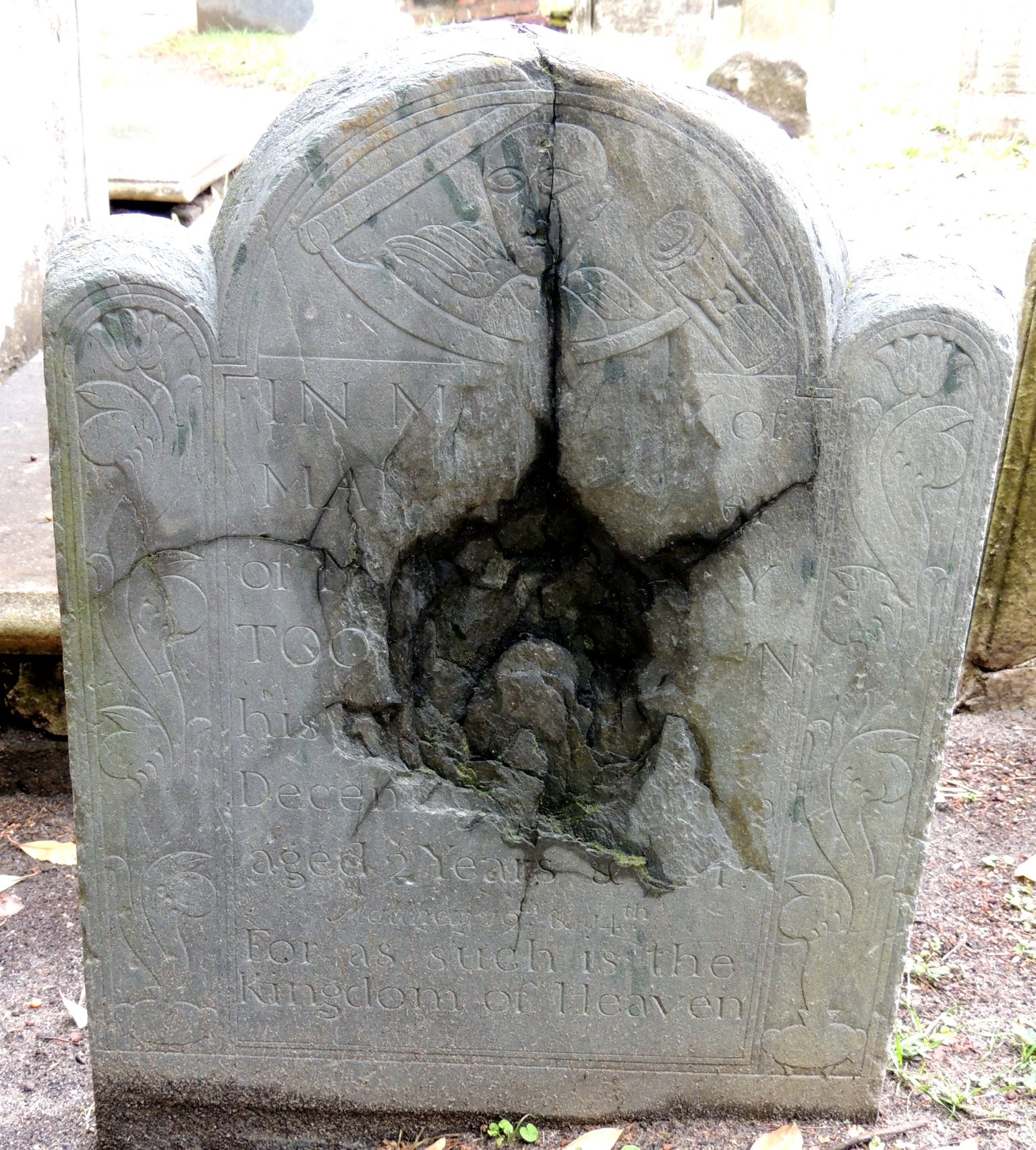 A little girls's gravestone that was damaged by a cannonball at Circular Church Graveyard in Charleston, SC.