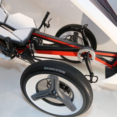 The trike utilizes a belt drive and disc brakes