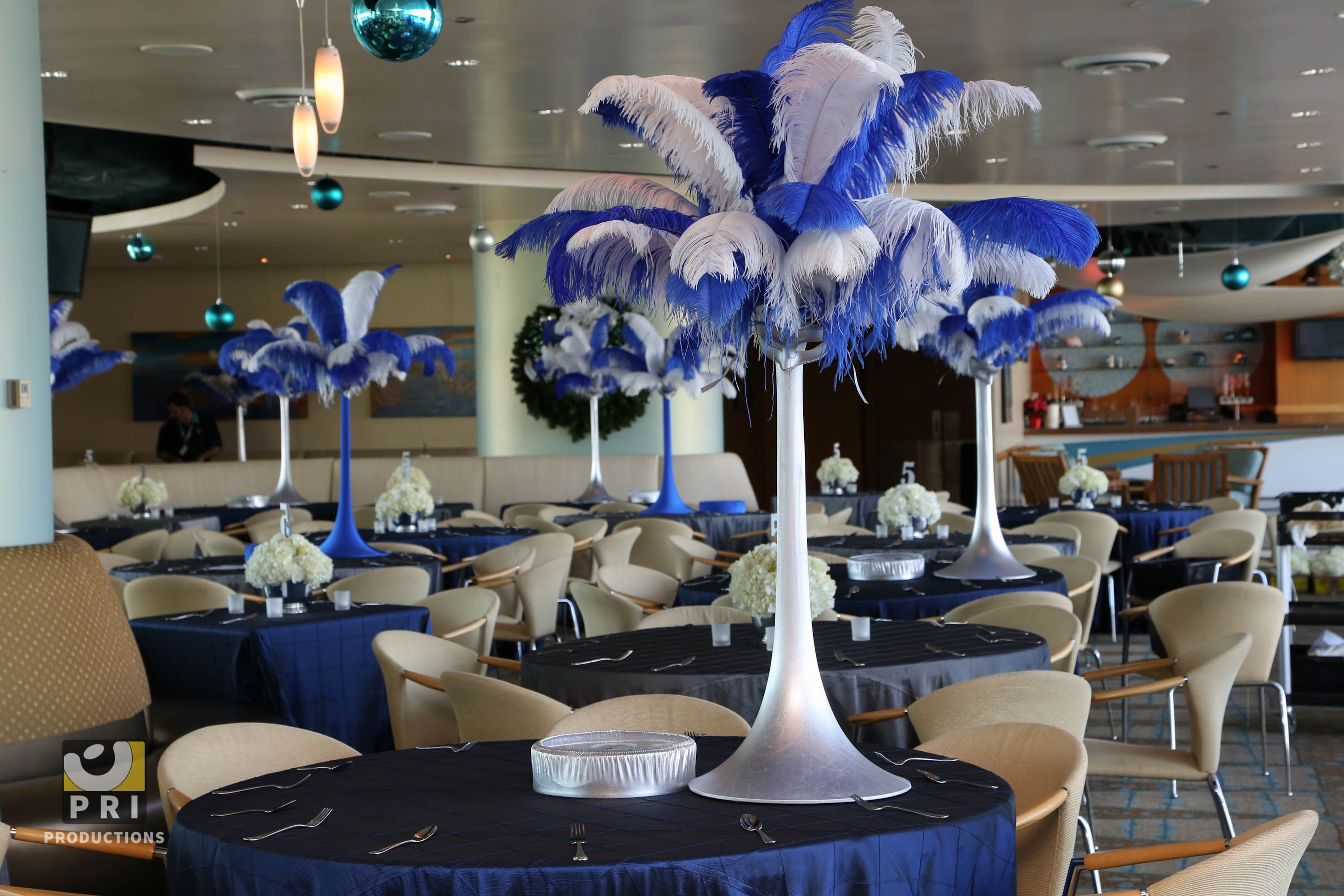 Tall blue and white feather centerpieces for a masquerade