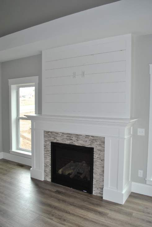White Shiplap Fireplace With Perfectly Placed Outlets For Mounting Your TV