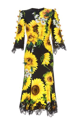 5e321c6dae7f0 This **Dolce & Gabbana** dress features a sunflower and daisy print with