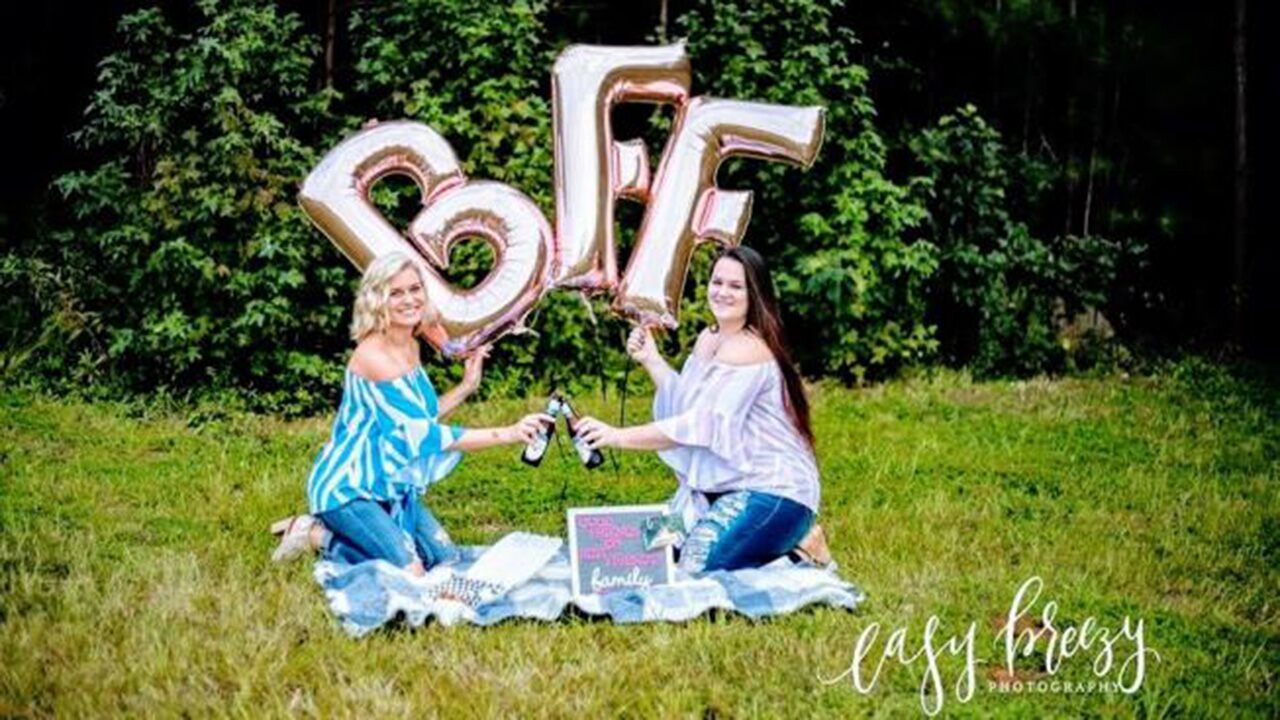 Best friends bring beer chicken wings to photo shoot celebrating friendship Nothing says lifelong friendship like shotgunning beers eating chicken wings and laughing til you cry.