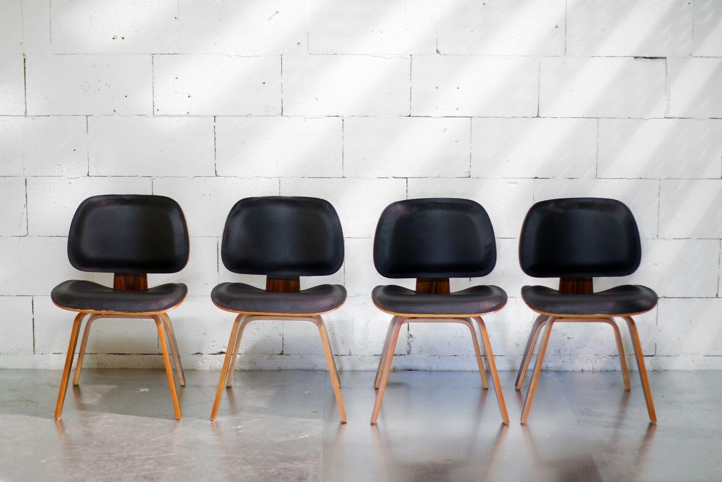Zwarte eettafel stoelen modern plywood en zwart skai eames lookalike
