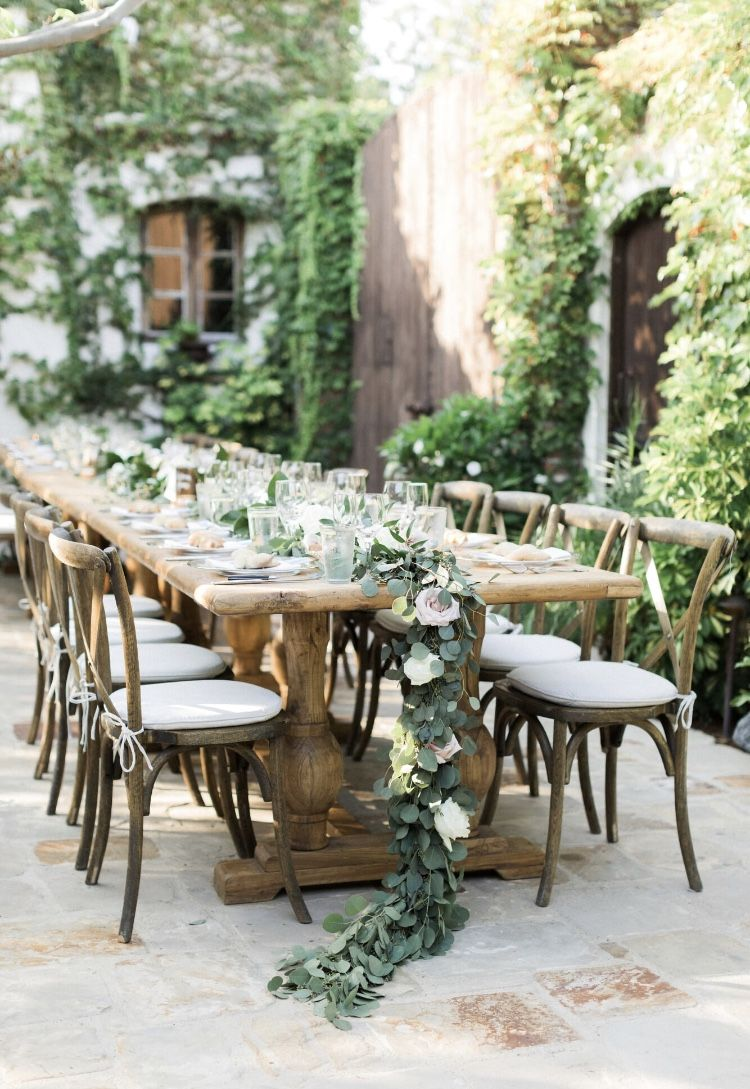 Farm Table with garland centerpiece draping off table Wedding at