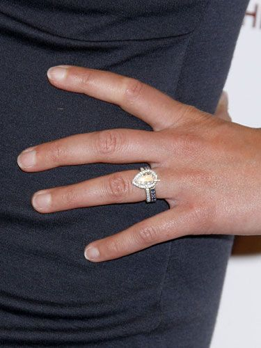 So pretty Pear shaped diamond engagement ring with halo pave band