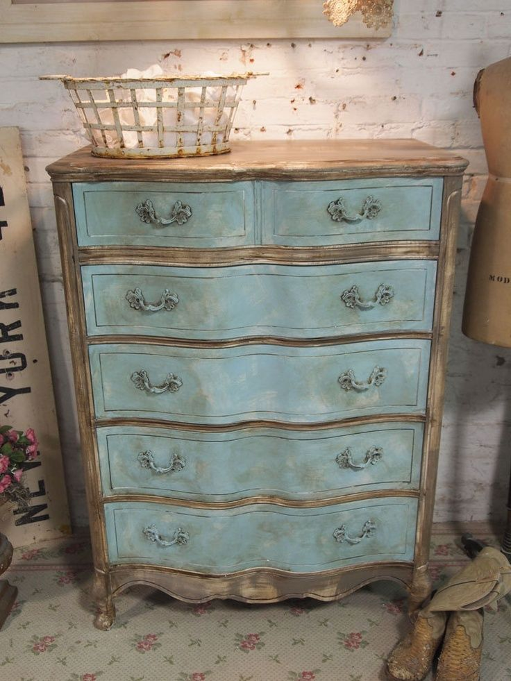 antiqued white with sea blue drawers distressed. i love the glass