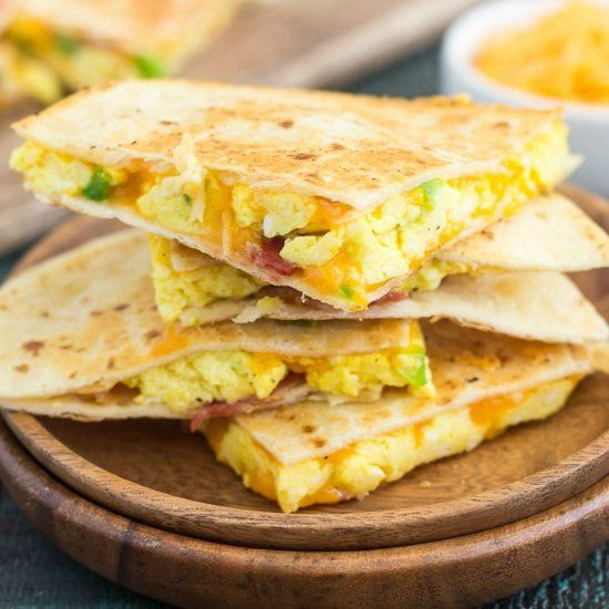 These Easy Breakfast Quesadillas are filled with fluffy, scrambled eggs, green peppers, bacon and cheddar cheeses!