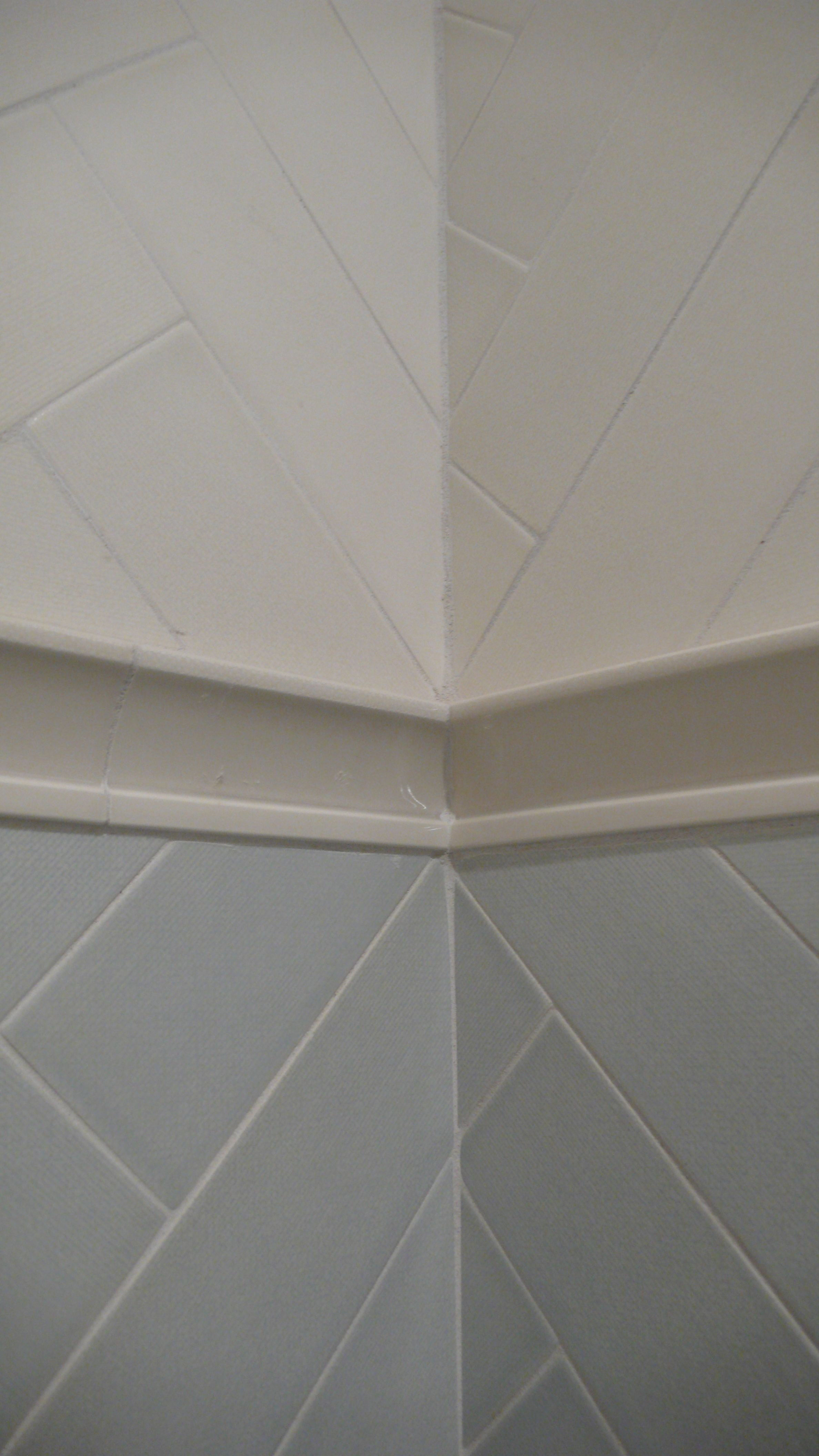 Filed Tile 3 X 9 In Sea And Sail And Chair Rail Trim Laid Out In A Herringbone Pattern Corner Detail Herringbone Tile Chevron Tile Tiles