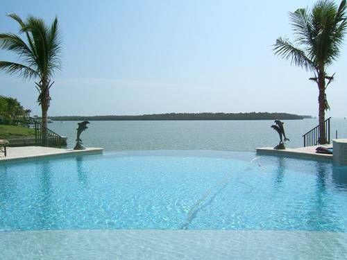 zero edge pool on coastal house plan by Weber Design Group