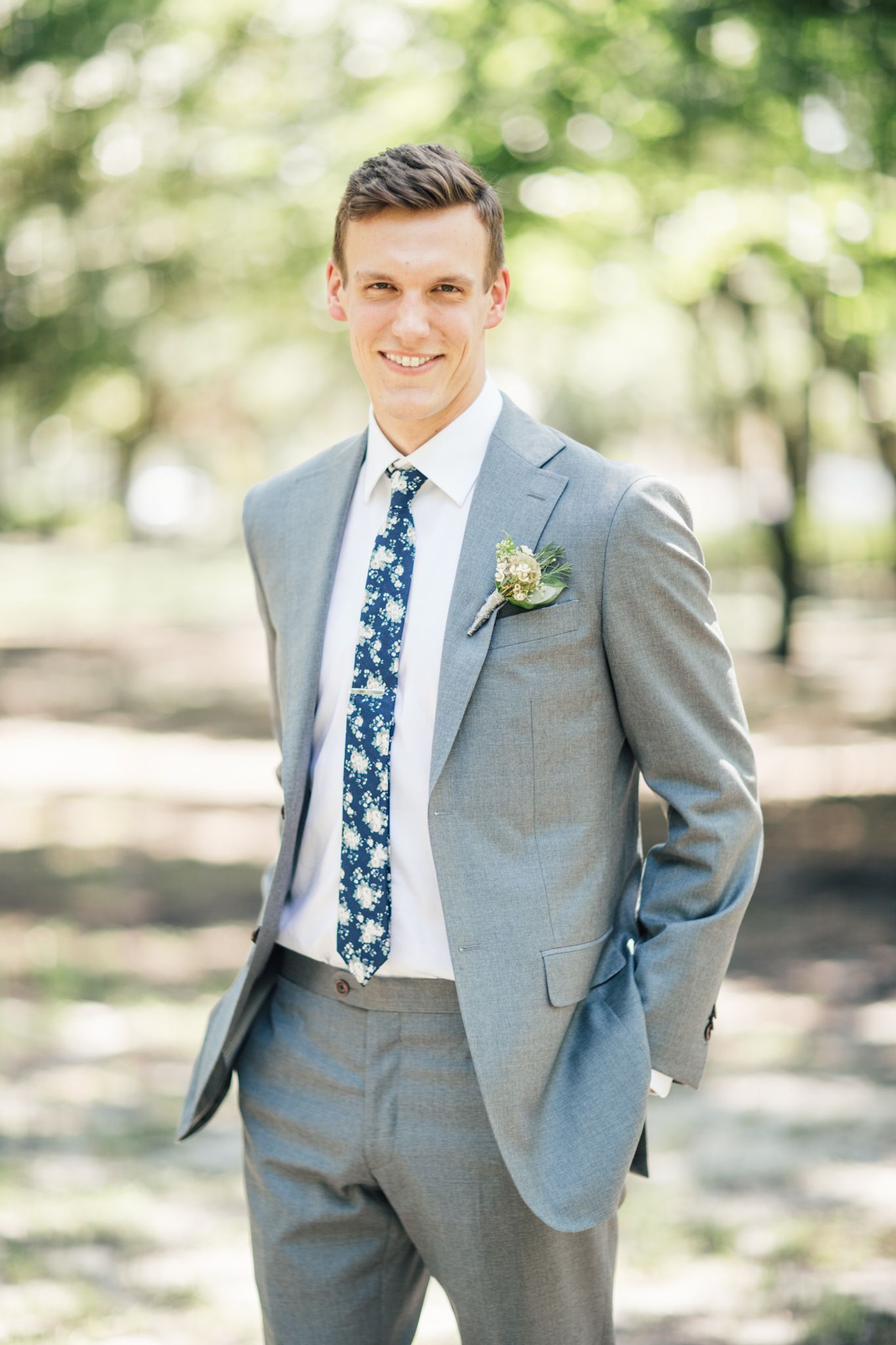 Groom wearing tailored grey suit with floral tie   07.25.15 ...
