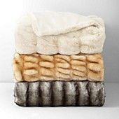 "Soft and luxurious, Hudson Park's faux fur throws are a glamorous accent fit for any decor. | 82% Acrylic, 17% Polyseter, 1% Spandex. Back 100% Polyseter | Machine wash | Imported | 50"" x 70"" 