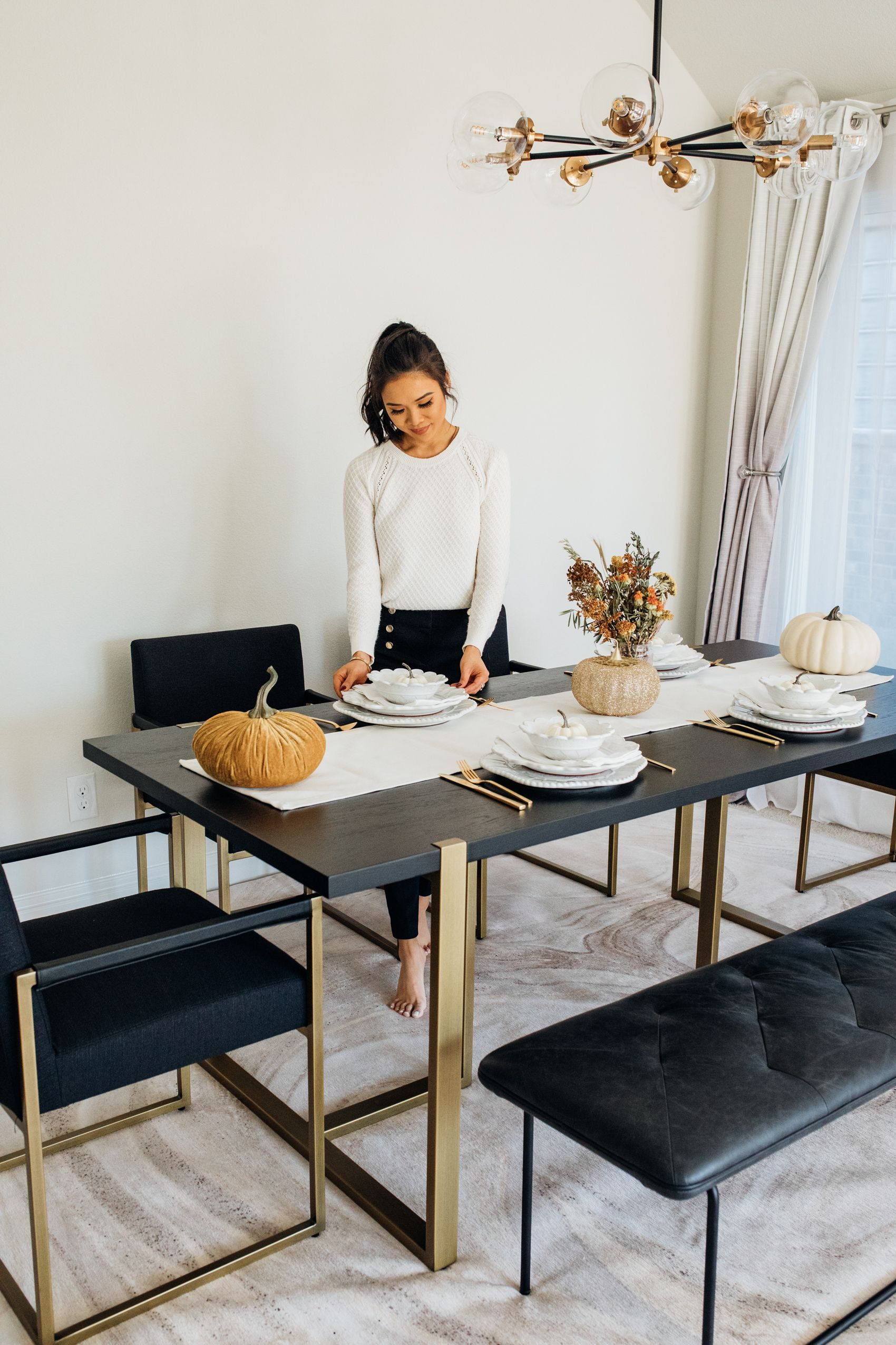 Article Oscuro Dining Table With Gold Legs In A Modern Dining Room