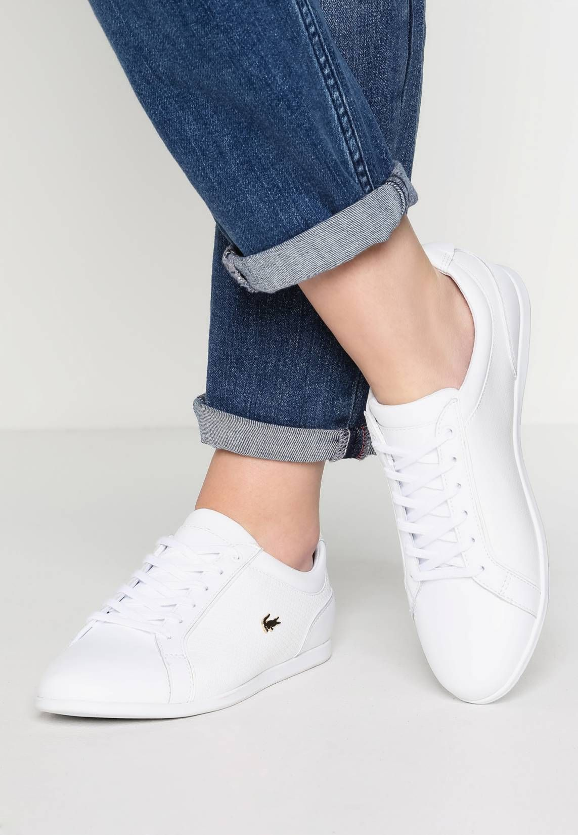 36f36b0f96 Lacoste. REY - Trainers - white. Pattern:plain. Sole:synthetics. Shoe  tip:round. Padding type:Cold padding. Heel type:flat.