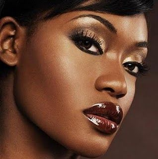 brown skin make up. Pretty eyes, not sure about the lipstick :/