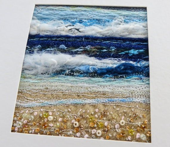This unique fibreart seascape measures 2.25 x 2.75 inches and is mounted into a sturdy handmade card measuring 5.5 inches square. The embroidered and beaded textile art has been created using a combination of machine and hand stitching, embroidery & beading. The background has been stitched from