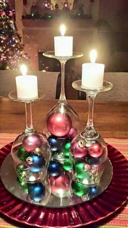 Wine glasses upside down with ornaments, as candle stands