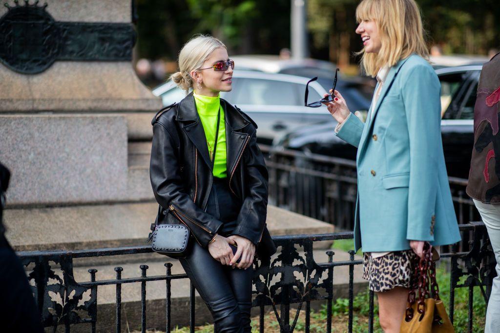 deea33f66 Caroline Daur wearing neon turtleneck, black leather jacket and ...