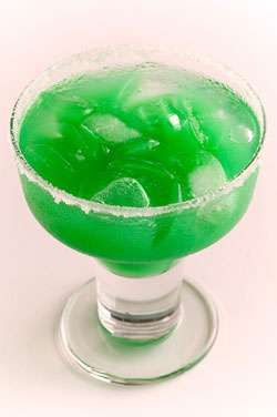 Kiss Me I'm Irish: 1 1/2 parts Hornitos Plata Tequila, 1 part DeKuyper Pucker Island Blue Schnapps, 1 part Mango Juice, 1 part Pineapple Juice. Shake with ice and strain into a martini glass.