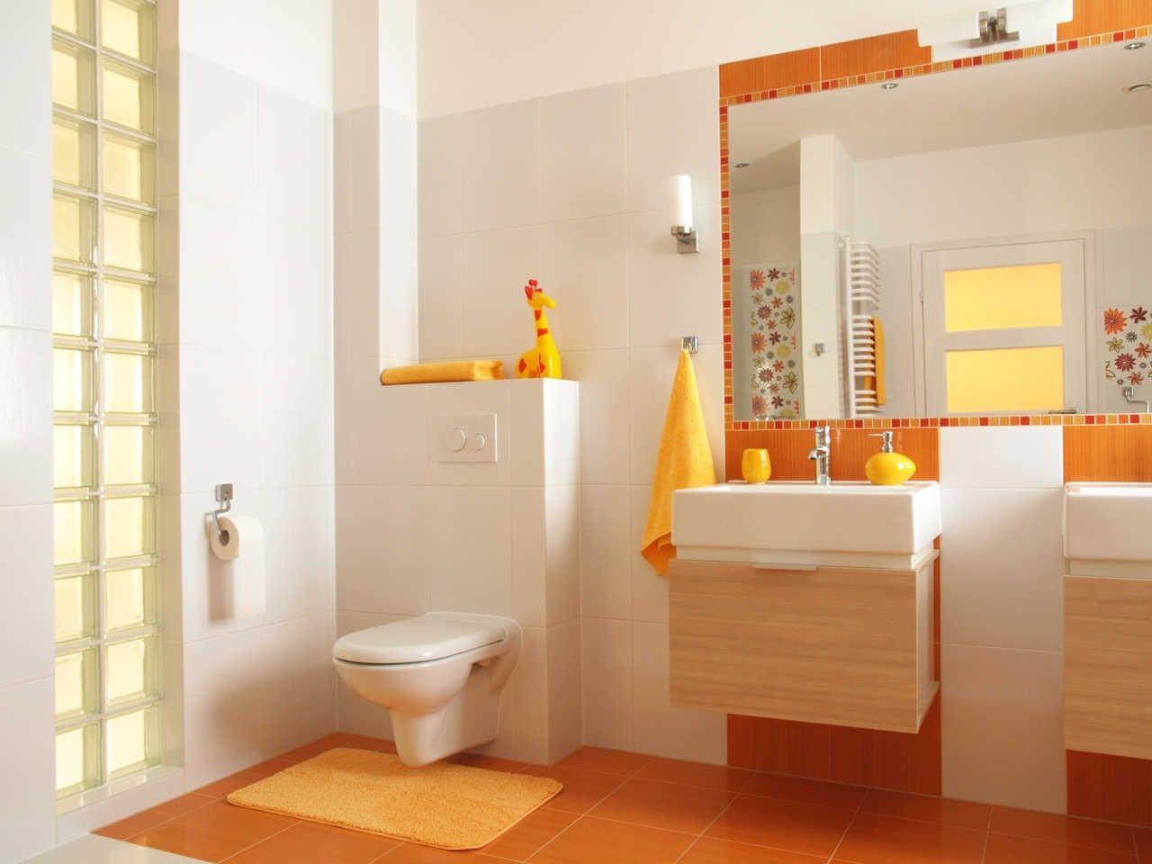 dale luz a tu baño. #baño #diseño #círculos #naranja | decoración