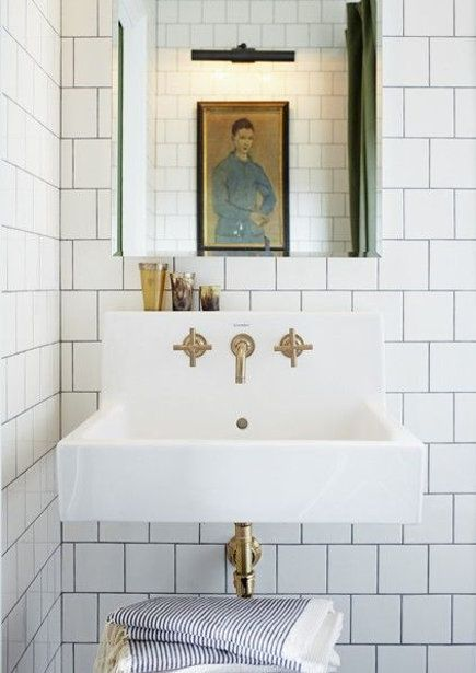 brass bathroom fixtures - Mandy Milk's master bath with Duravit sink and Kohler Purist brushed bronze faucet - House & Home via Atticmag