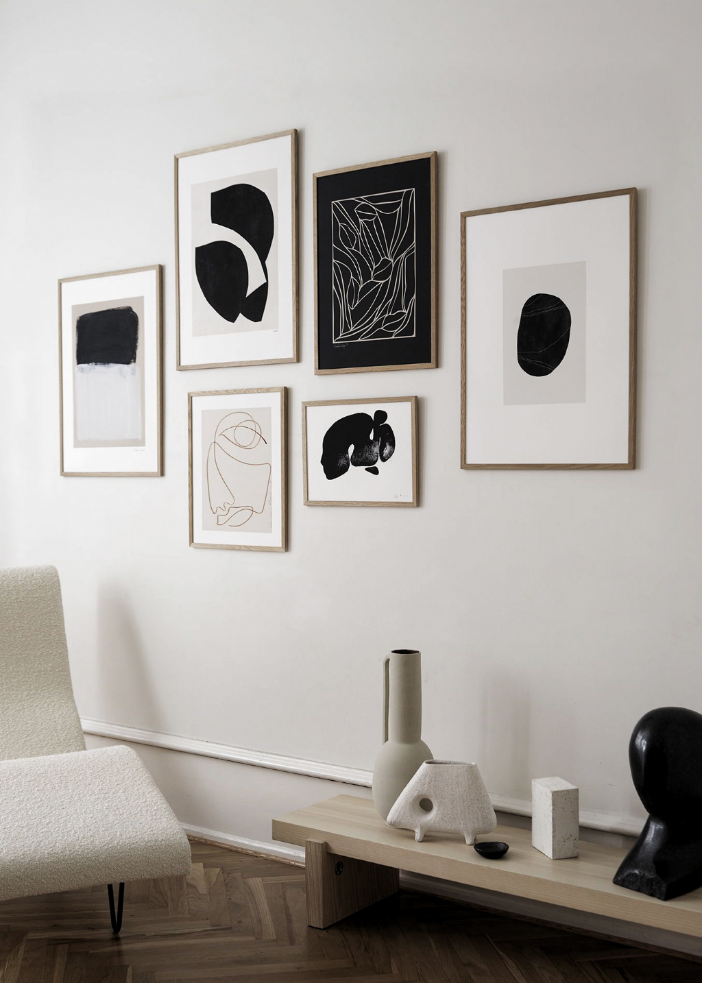 Stunning Abstract Art Wall Inspiration with black accents. ⁠Scandinavian living room with art wall. Minimal poster design available from The Poster Club.  #art #artprint #artposter #tpc #theposterclub #interiordesign #nordicdecor #homestyling #artwall #scandinavianliving