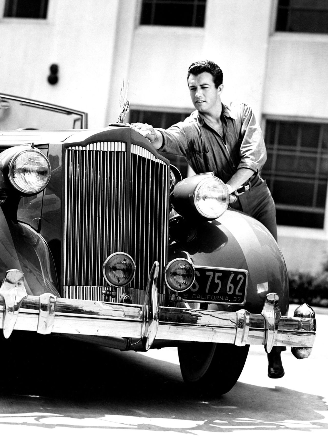 Robert Taylor and his Packard, 1930s | Packard, Photo, Photo printing