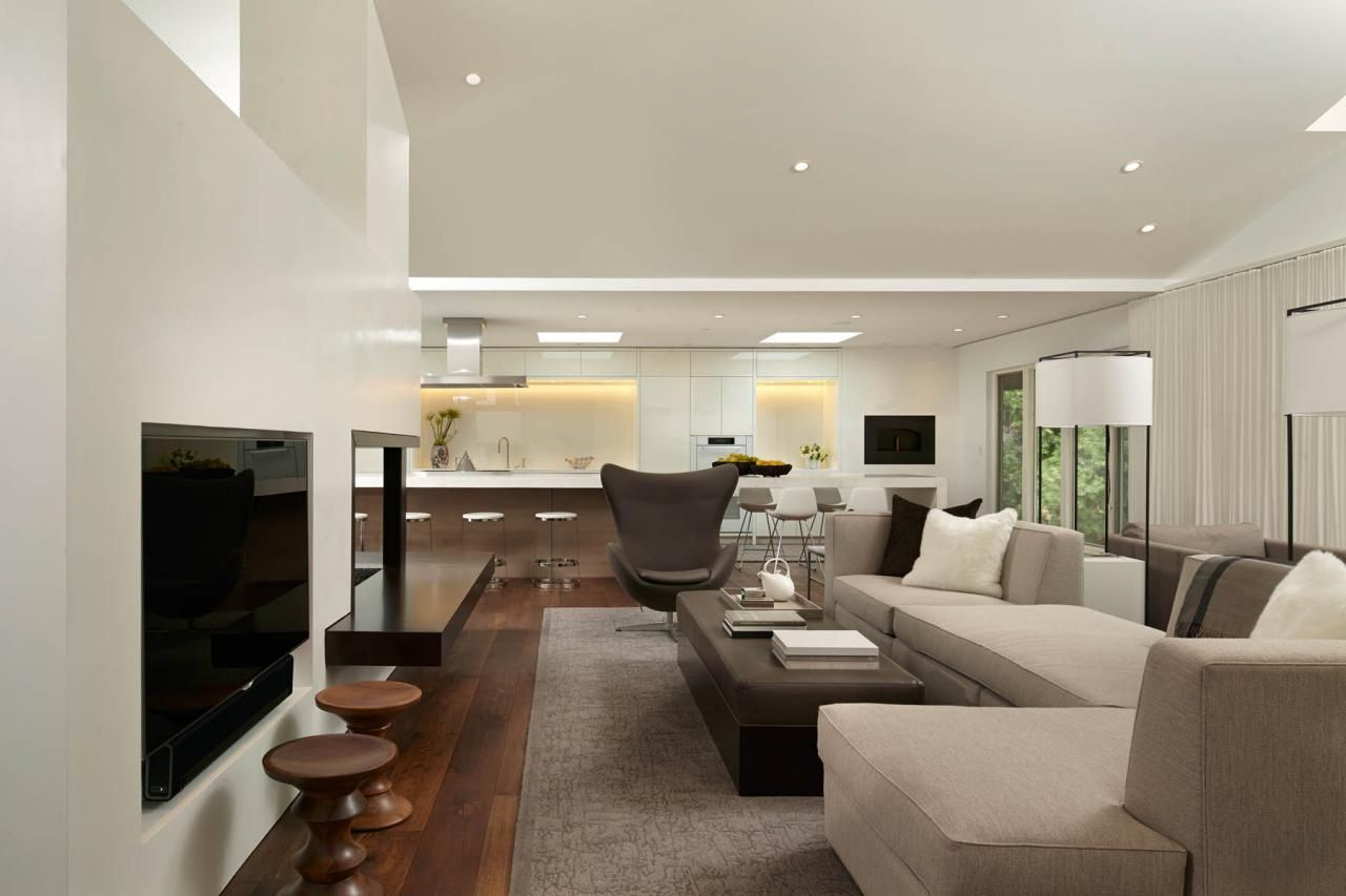 This living room has a roomy feel and is furnished with sleek ...