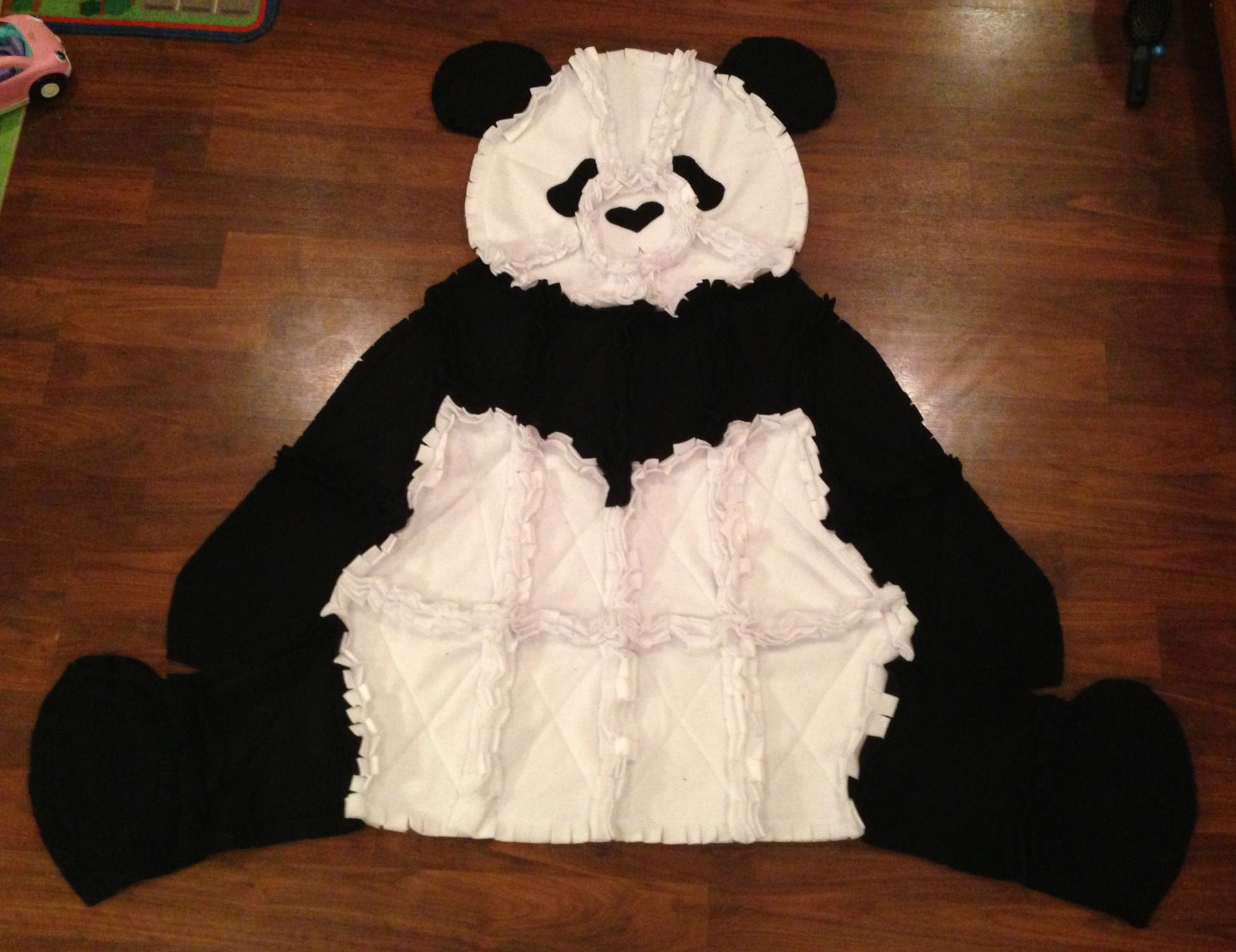 "Adorable fleece panda bear. Measures approx. 52"" x 60"".  Makes a great throw blanket for your favorite kid"