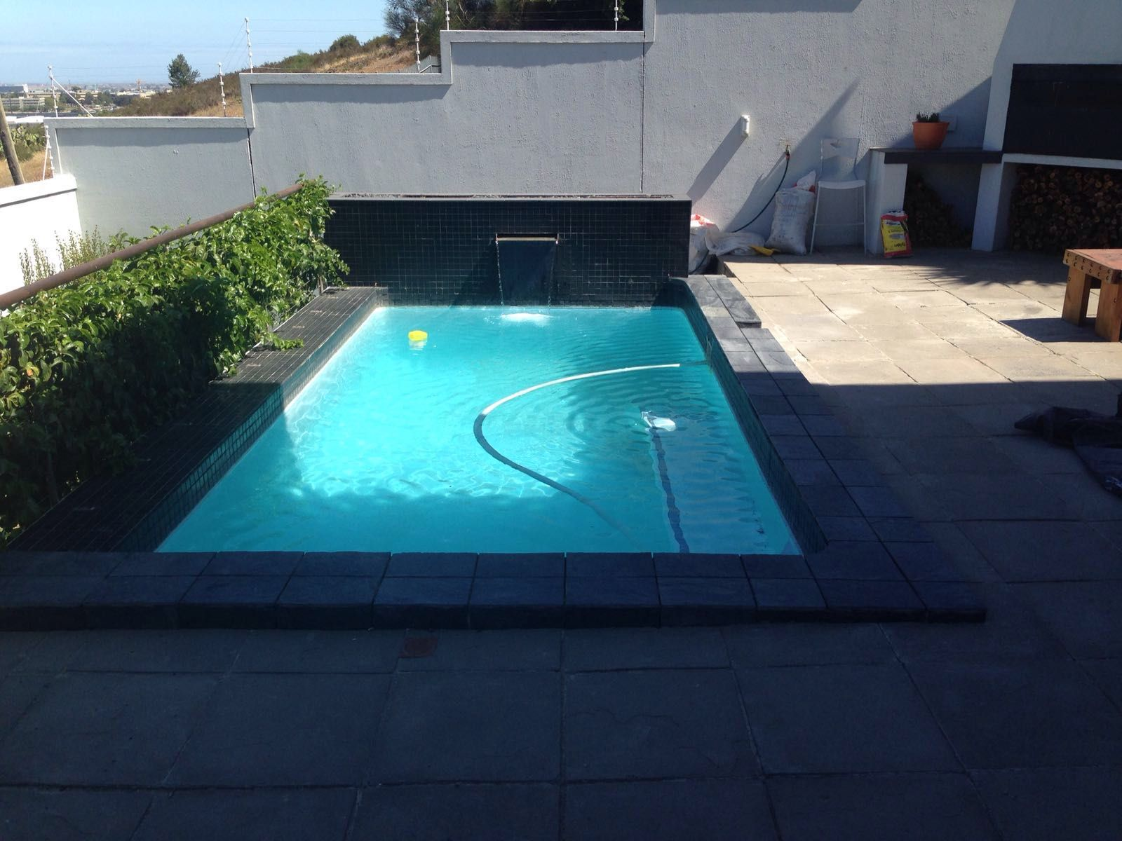 Pool Coping Re Tiled With Black Slate Tiles And Black