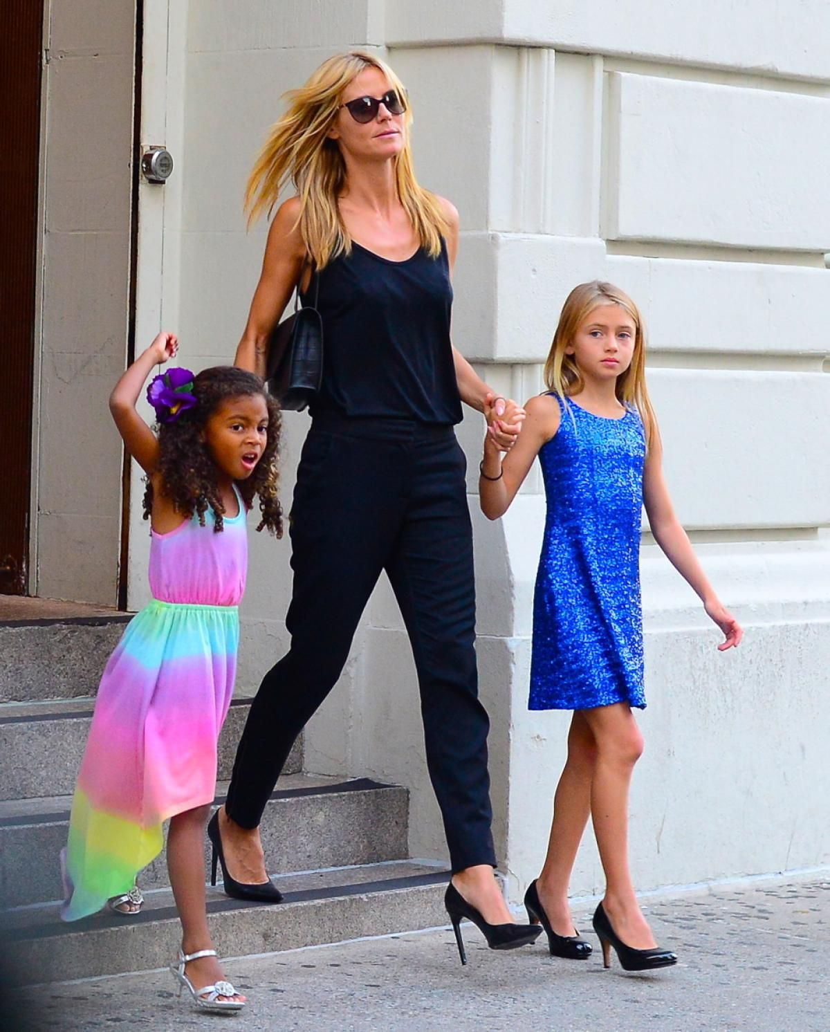 586392d92fe28 The family that wears heels together stays together? Heidi Klum took  daughters Lou and Leni Samuel out to Nobu restaurant in New York City on  July 19, 2014.