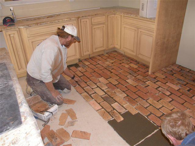 I Can Definitely Do This If They Can Laying A Brick Floor Diy Kitchen Flooring Diy Flooring Brick Flooring