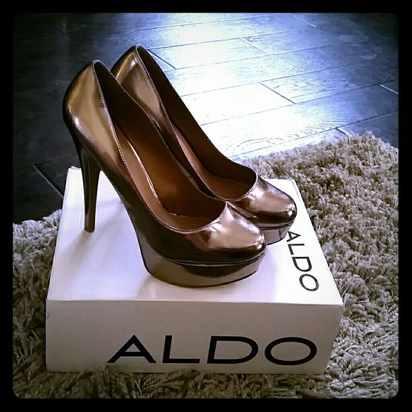 Aldo CapeCoral Platform Pump Glossy patent pump is lifted with a chunky platform and soaring heels. Details above. ALDO Shoes Platforms