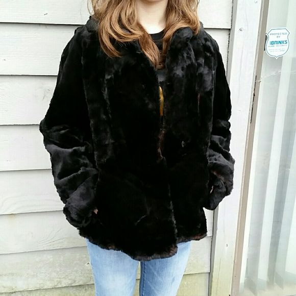 """Vintage Black Fur Coat S-M Fabulous black fur coat from Wagenheim's Fur Salon of Amsterdam,  NY. It features a black lining with embroidered flowers and two front pockets.  It has a single hook and eye closure. This has no size tag, but the model in the picture is 5'4"""" and 120 pounds. She normally wears a small, and this fit her with a bit of extra space. I wear a medium and it fit me fine.  No trades. Reasonable offers welcome through the offer button. Jackets & Coats"""