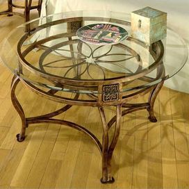 Glass Top Coffee Table With An Openwork Cast Metal Base And A