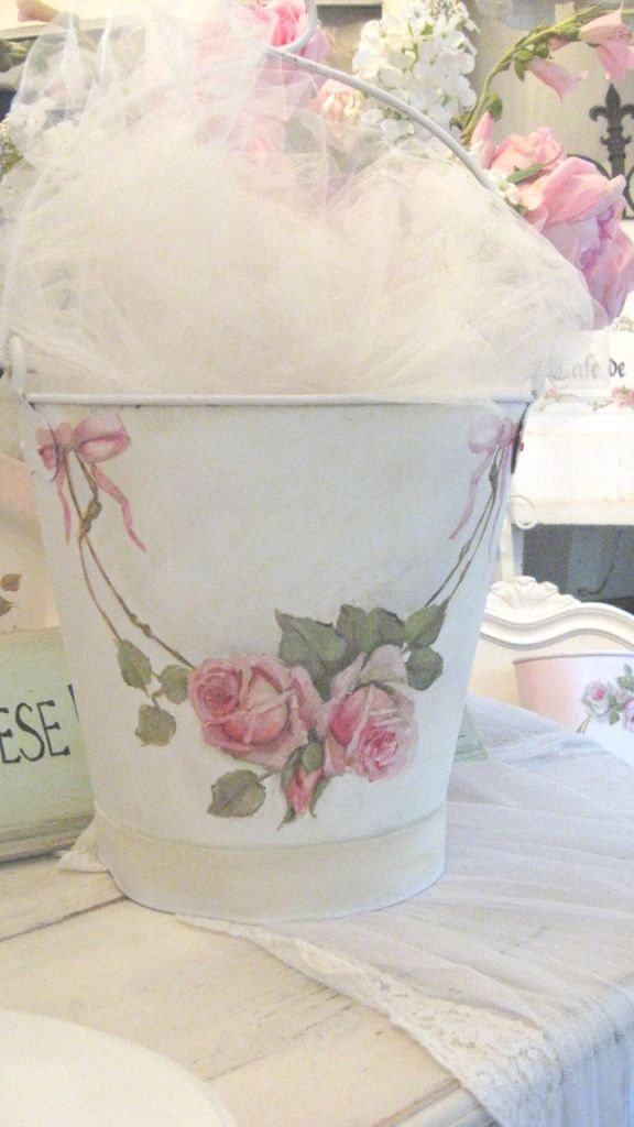 This beautiful metal bucket is hand painted by Cindy Ellis with her signature roses. It's now sold and no wonder; it was only $75.00!
