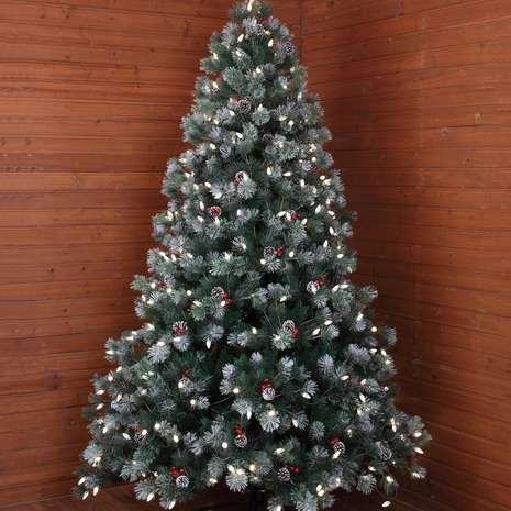 This Green Christmas Tree Features Seasonal Berry And Pine Cone Decoration And Is Also Fitted With Li Christmas Tree Cone Christmas Trees Pine Cone Decorations