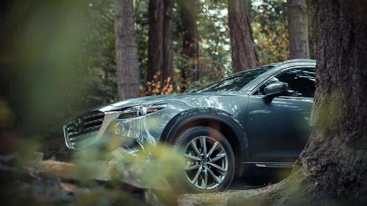 Inside The New 2022 Mazda Cx 9 Has Many Updates This Suv Offers A More Pleasant Cabin And A Larger Infotainment Screen Mazda Cx 9 Mazda Exterior Gray Paint
