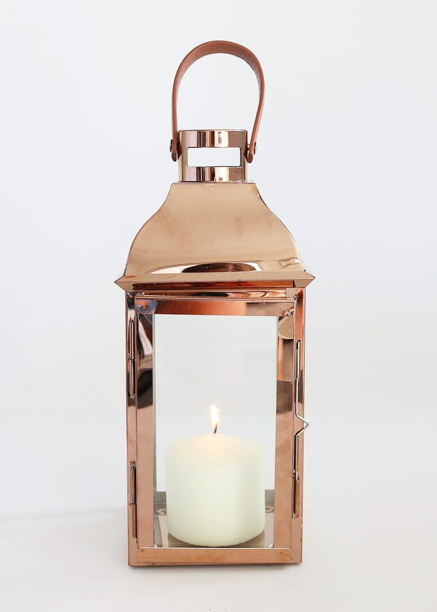 Decorative metal and glass candle lantern in copper with handle