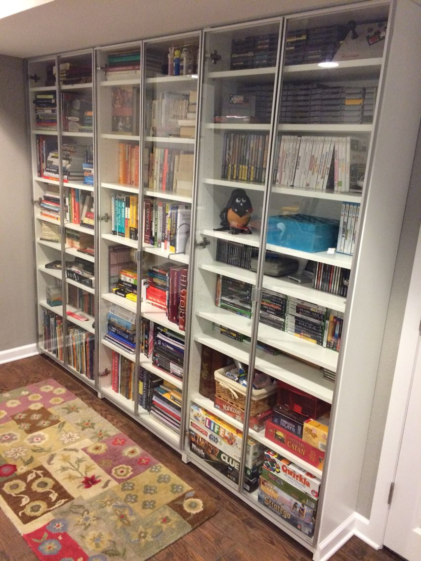 3 IKEA Billy Bookcases With A Few Extra Shelves And Oxberg Glass Doors Built In Book Video Game Board Library