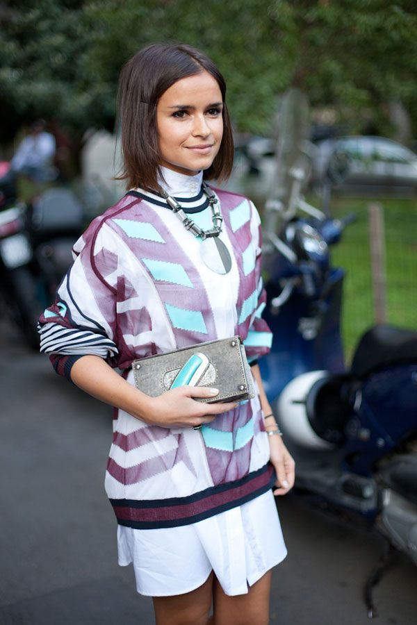 STREET STYLE SPRING 2013: MILAN FW - Miroslava Duma wears white and an Alexander Wang sweater.