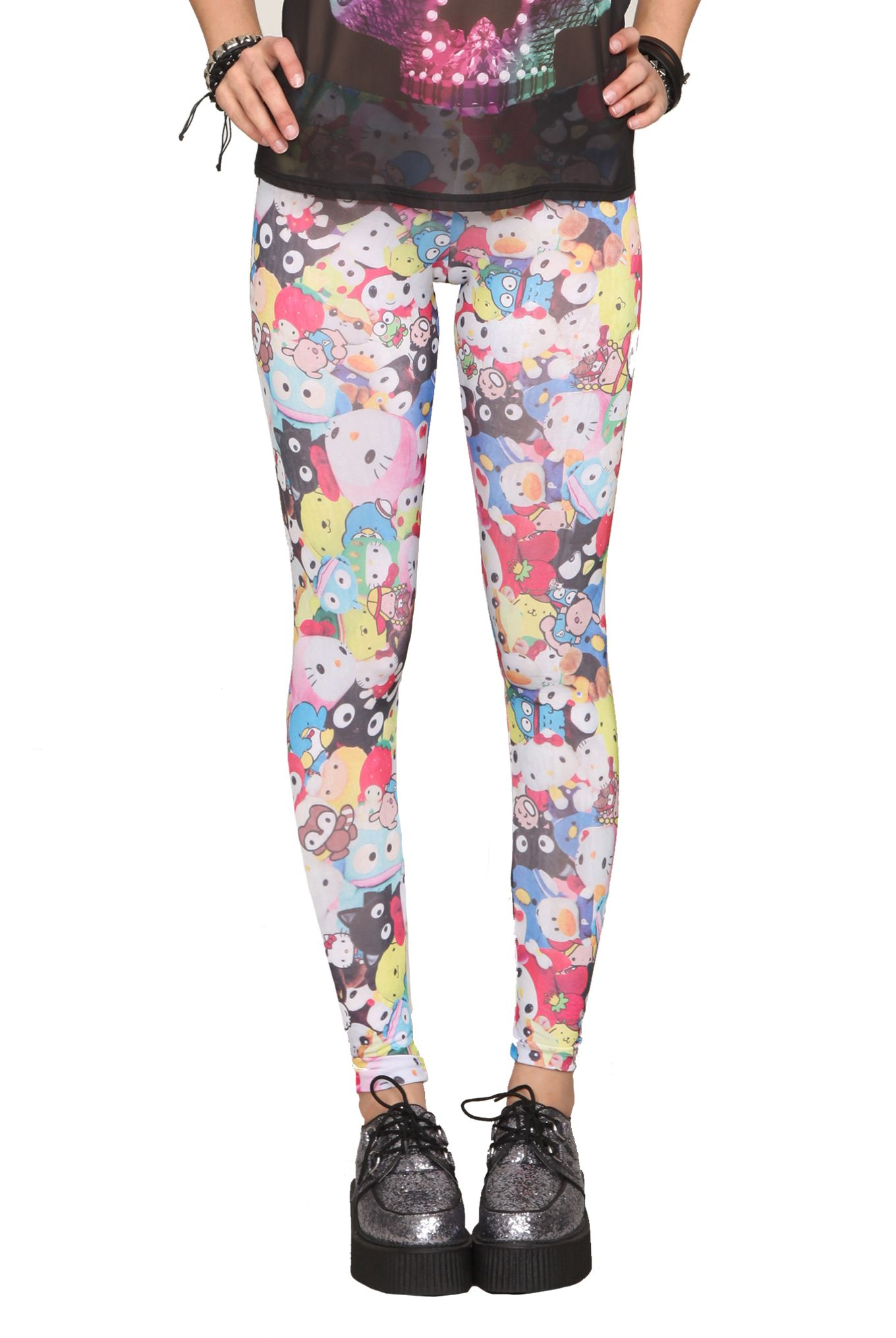 bbb82c154 Hot Topic leggings with all your favorite characters from the Sanrio  universe.