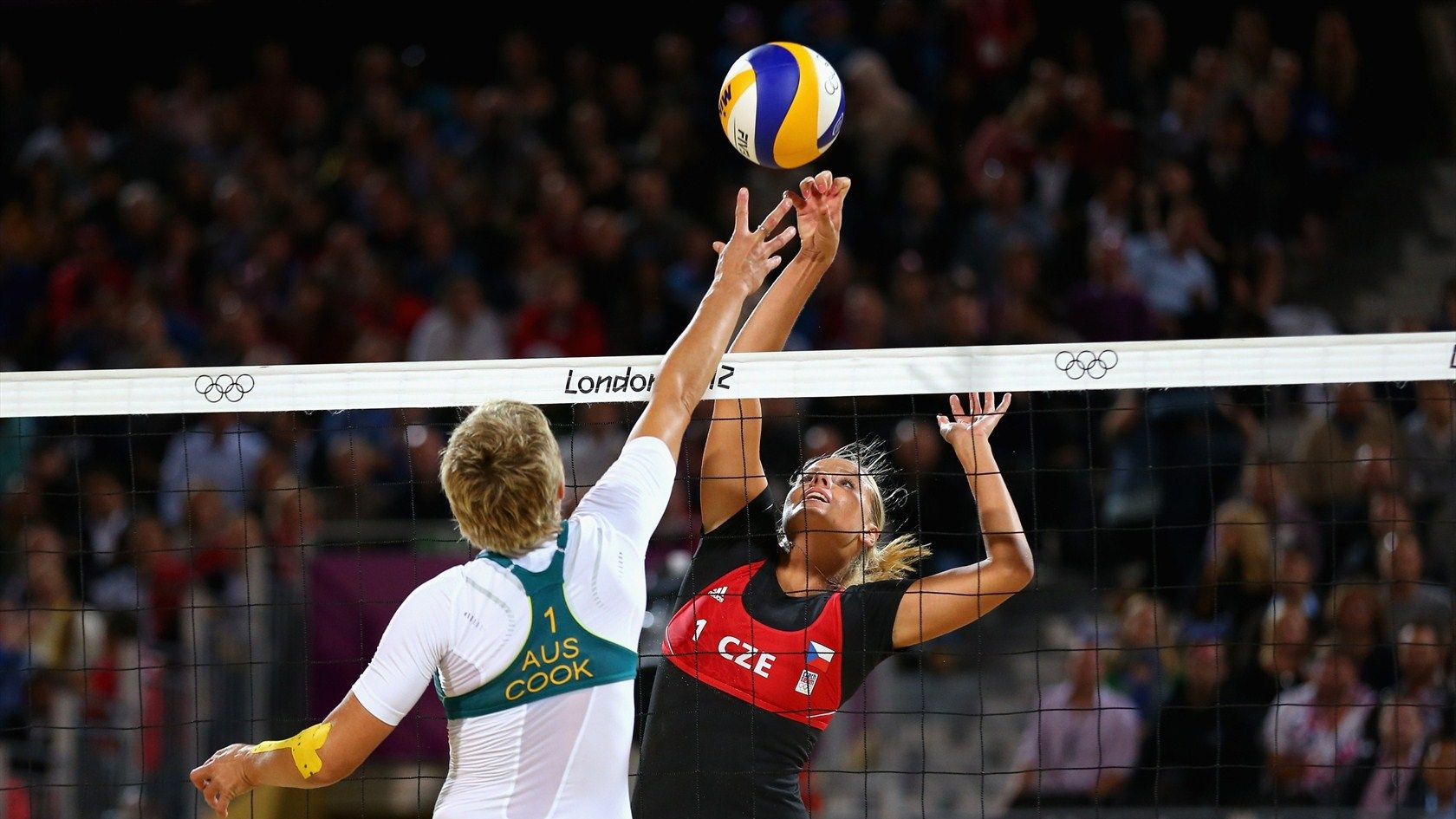 Five Time Olympian And Sydney Gold Medalist Nat Cook Of Australia Goes For The Kong Block Against Czech Republic M Volleyball Photos Beach Volleyball Olympics