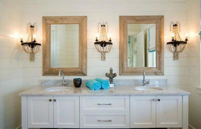 elegant bathroom with recessed medicine cabinet and wall sconces