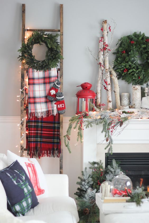 a few of these ideas are really great love the ladder here for hanging colorful plaid blankets - Farmhouse Christmas Decorating Ideas