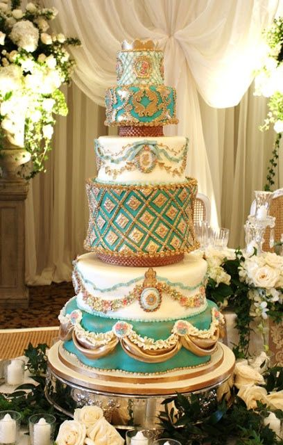 Love the turquoise, gold and white of this cake, where every tier is different and lovely. Description from pinterest.com. I searched for this on bing.com/images