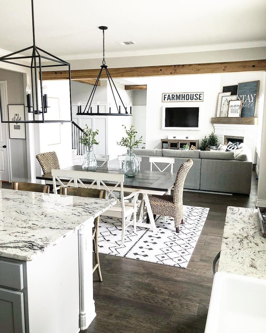 Farmhouse Style Open Layout With Kitchen, Dining Room And