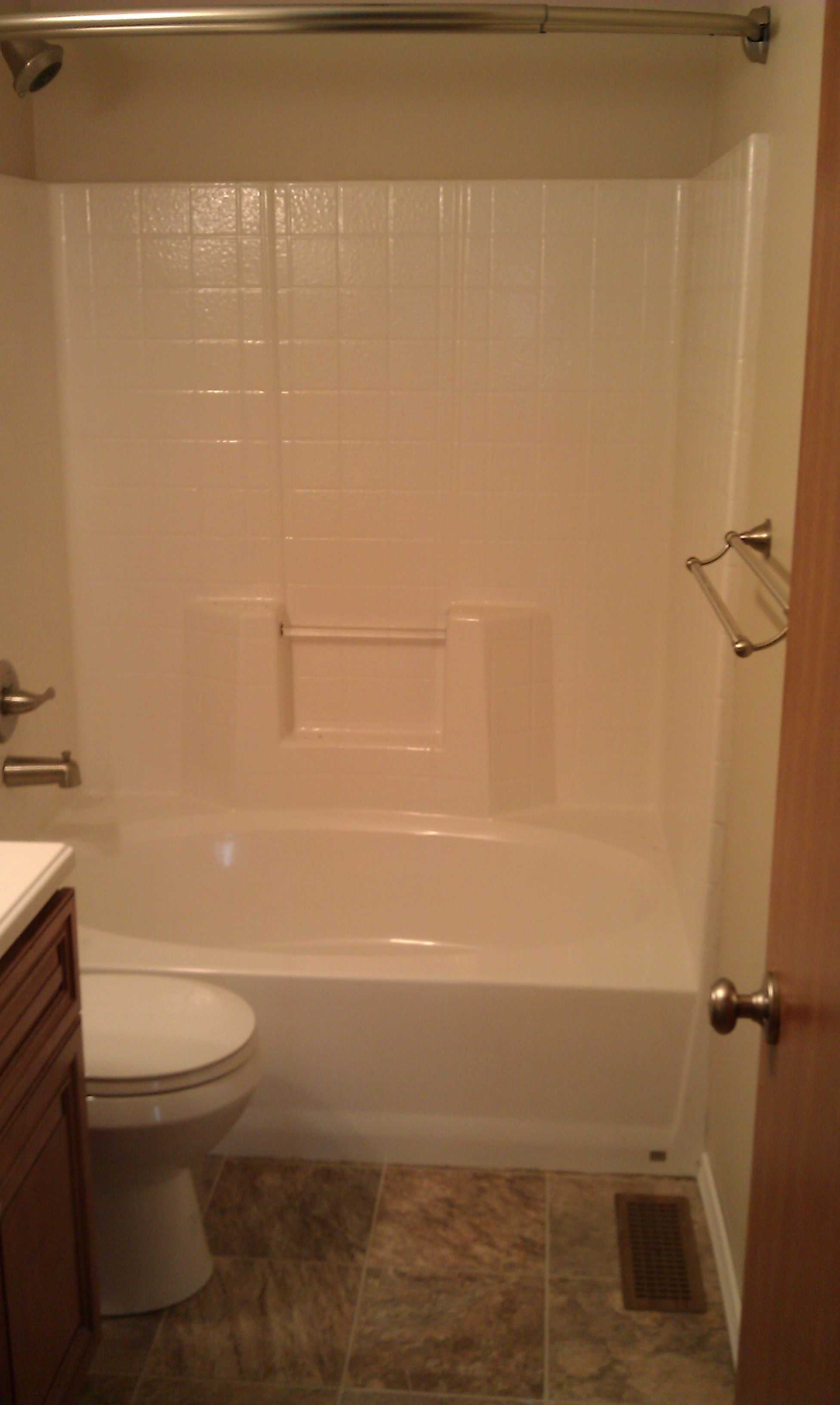 Our spacious oval tub/shower with curved shower bar. The shower bar ...