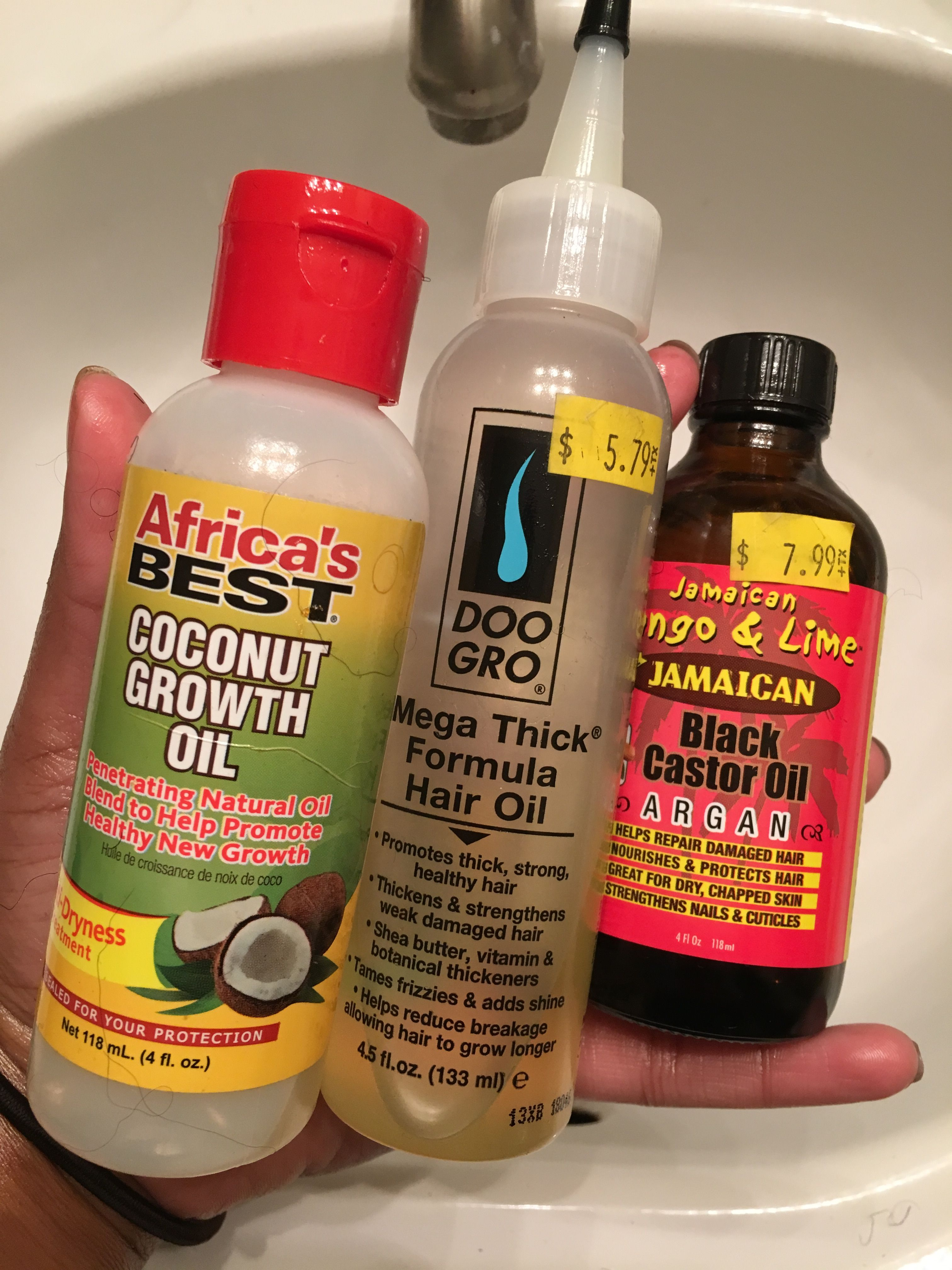 This is my current hair growth/strength mixture. I put all three )equal parts) in a small bottle and oil my scalp every other day throughout my protective styling.